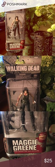 AMC's The Walking Dead Maggie Articulated Figure Attention TWD fans ! New in box McFarlane Toys Series 5 Maggie Green , with assault rifle, gun and knife ! Serial # 231213KF. Awesome and sexy Maggie wearing jeans and tank top (and blood spatters) . Fully Articulated shoulders, elbows , and hands . An absolute MUST HAVE for a true TWD fanatic ! Other