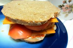 Vegan sandwich with Seven Grain Crunch bread from Spring Mill Bread Company, Just Mayo, Sriracha, Field Roast Tomato Cayenne Chao Slices, and local organic heirloom tomato