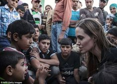 Back to work: Angelina Jolie listening to Syrian refugees in a Jordanian military camp based on the Jordan-Syria border. She will always have her detractors and haters, but she is bringing to public light severe humanitarian issues worldwide.
