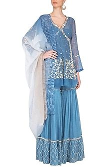 Featuring a blue angrakha kurta in mul mukaish base with cut work, sequins, gota pati, pearls, resham and zari embroidery and organza border at the bottom. It is paired with matching sharara pants with gota ribbon, pearl work and shaded dupatta in organza base.