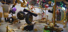 Title:                Maya Amor  Size:                15'.5'' x  21'  Technique:       Hand-Building Materials:        Various Materials - car wheels, plastic balls, foam, cardboard, plastics, wood, bubble wrap, cloth, thread, tree branches, metal rods, cloth, thread, metal rods, and packaging peanuts. Date:                 2015  Location:         Alfred University. NY Alfred University, Car Wheels, Bubble Wrap, Building Materials, Peanuts, Tree Branches, Cosmic, Maya, Balls