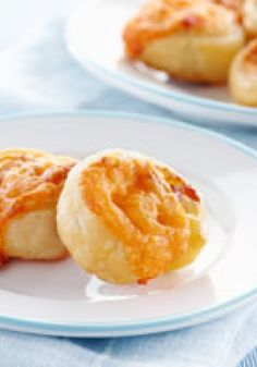 Bacon-Cheese Appetizer Coins – Cream cheese, shredded Cheddar and bacon bits are rolled into puff pastry logs and sliced thinly to make these cheesy, flaky appetizer coins.