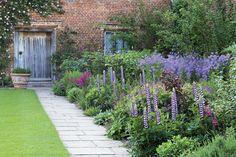 sissinghurst gardens england | The purple border in early summer at Sissinghurst Castle Garden, Kent ...