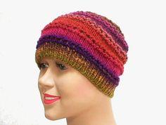 Lacy cloche hat  knit in stripes of moss green, rust, orange, purple, fuschia, cranberry, plum, chestnut brown & umber.......by taschekats