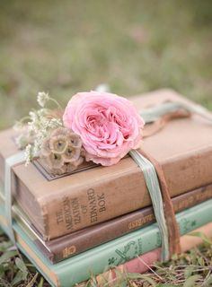 Vintage books, ribbon, and flowers