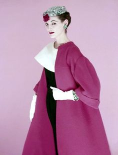1954    Model is wearing a printed linen turban and a full red fleece coat by Originala over a navy dress with a large collar in white pique by Larry Aldritch.