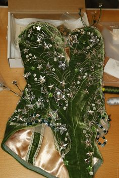 An emerald green velvet bodysuit with Swarovski crystals worn by Miranda Kerr