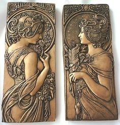Art nouveau mucha style wall hangings. A pair of plaques in a silver, gold or warm bronze effect - made in the Mucha style, new, sized at some 26 cms x 11 cms each with a hanger on the back Finished in a non tarnish coating and made in a resin/plaster Also available in cream. Listed in my shop A pleasure to make and share