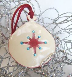 Red Star with Turquoise Rhinestones Christmas Pottery Ornament