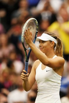 Maria Sharapova Photos: Day Six: The Championships - Wimbledon 2014. Maria Sharapova of Russia celebrates after winning her Ladies' Singles third round match against Alison Riske of the United States on day six of the Wimbledon Lawn Tennis Championships at the All England Lawn Tennis and Croquet Club at Wimbledon on June 28, 2014 in London, England.