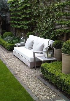 white upholstered cushions | lush green terrace