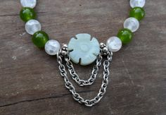 This bracelet was handmade with 3 different Semi Precious Gemstone beads (Crackle Rock Quartz, Dark Green Jade, New Jade) & specially charged with Healing Reiki Energy.