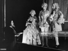 Queen Elizabeth, Princess Margaret (1930 - 2002) and Princess Elizabeth during a rehearsal of 'Cinderella, the first Royal pantomime at Windsor Castle. The two princesses are in costume for their parts.