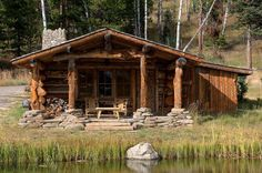 Cabin covered porch. Perfect place to relax, read, and reflect.