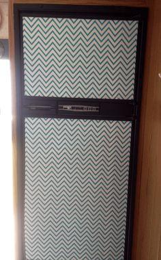 Chevron contact paper refrigerator in RV kitchen