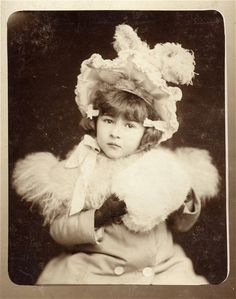 Turn of the century Victorian/Edwardian fashion on a beautiful little lady. Beautiful hat and fur collar, muff.