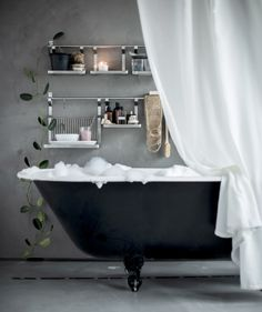 Create a relaxing spa zone in your bathroom and hang ENUDDEN wall storage next to the bathtub.