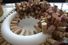 How To... Cork Wreath , Easy but I recommend putting some glue on the end you are sticking into the styrofoam as some came loose and came out.