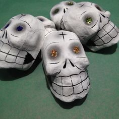 Need something not too expensive but authentic for your ofrenda or Muertos decorating? These glittered skull masks are made of paper mache and have a little more sinister look than the ones I usually gravitate toward. It must be those shadows or dark circles around their eyes! BUT they have