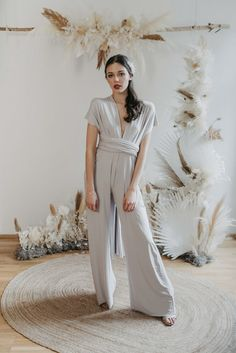 Thanks to the stretchy material and elastic band around the waist, you can wear it from size 34 to 40 Perfect fit with endless ways to wrap and wear. Bridesmaid Outfit, Bridesmaids, Drapery Wedding, Silver Jumpsuits, Ibiza Wedding, Convertible Dress, Jumpsuit Dress, Just Amazing, Slow Fashion