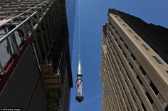 One World Trade Center Soaring via dailymail.co.uk: The final section of the spire is raised to the top. AFP/Getty Images #One_World_Trade_Center