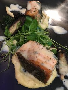 Citrus and dill seared salmon served with watercress and roasted parsnip puree, green peas, crispy dill, shrimp mousseline stuffed morel mushroom with citrus burr blanc