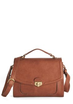 Classy Commute Bag. Tote your daily essentials in style with this chic satchel on your shoulder. #brown #modcloth