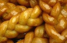 My mom makes THE BEST! Koeksisters are a South African syrup-coated twisted doughnut that originally come from the Cape Malay community. The Afrikaners have a slightly different koeksuster recipe that is more crispy and sweeter with more syrup on them. South African Desserts, South African Recipes, Ethnic Recipes, Croissants, Koeksisters Recipe, Food Hub, Thinking Day, International Recipes, The Best
