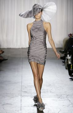 Image from http://coolspotters.com/files/photos/170878/christian-siriano-s09-strapless-layer-dress-profile.jpg.