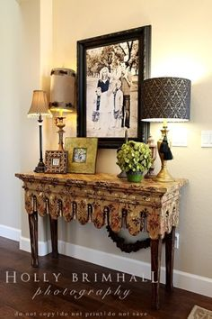 Inviting entrance with lamps and family photos.