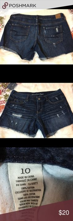 American Eagle Distressed Denim Shorts AE size 10 distressed denim shorts - worn once. Dark wash with distressing on front and back and frayed hem. American Eagle Outfitters Shorts Jean Shorts