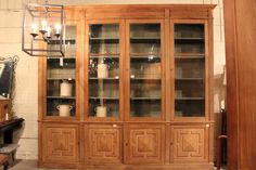 FRENCH PAINTED BOOKCASE CABINET WITH FOUR GLASS DOORS ABOVE FOUR SOLID DOORS