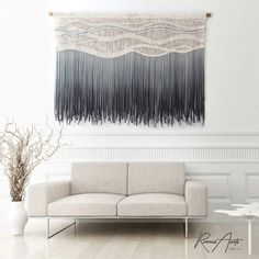"""$3,000 USD Strong colors like black and gray will make for a great focal point of color that grounds, anchors, and brings a sophisticated look to your space. Using these colors in textured upholstery such as a macrame will also add visual interest and depth - keeping the room almost dancing with tactile details.D I M E N S I O N S. Dowel width: 71"""" (180 cm) Macrame height: 47"""" (120 cm) Free worldwide shipping! Large Macrame Wall Hanging, Hanging Tapestry, Living Room Modern, Living Room Decor, Boho Backdrop, Contemporary Wall Art, Beige Walls, Fiber Art, Color Schemes"""