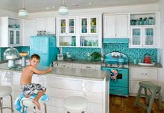 Teal and white inspiration for our kitchen. I definitely want a more simplistic backsplash. And, of course, black and white floor tiles.