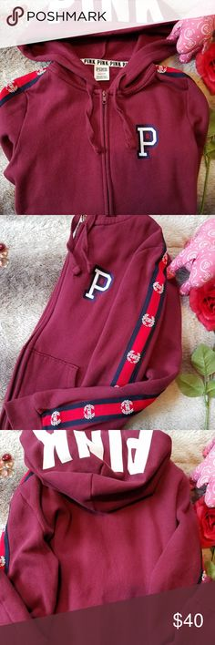 Pink VS Zip Up Burgundy colored Victoria Secret Zip up with navy and red stripes on sleeves. There is no decal or design of any kind on the back. Victoria's Secret Tops Sweatshirts & Hoodies
