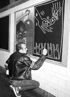 Keith Haring doing his thing in the NYC subways.