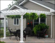"8' X 12' Vinyl 2 Beam Pergola Shown With Wall Mounted Kit, No Deck, 8"" Round Tapered Vinyl Columns, and 12"" Top Runner Spacing"