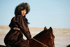 A Turanic girl on a horse.
