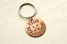 "7/8"" Copper Circle Small Pet ID Tag, Hand Stamped Cat ID Tag, Dog ID Tag, Handmade Pet Accessories, Round Pet Tag, Arrows Anchor Paw Print by KirasPetShop on Etsy https://www.etsy.com/listing/268869479/78-copper-circle-small-pet-id-tag-hand"