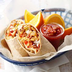 Breakfast Burritos Combine hash browns, sausage, bacon, eggs, cheese and chopped veggies for a hearty breakfast tortilla. Top the colorful mixture with cool sour cream and spicy salsa in this recipe inspired by RAGBRAI vendor Farm Boys. Breakfast Dishes, Breakfast Time, Breakfast Recipes, Breakfast Tortilla, Egg Tortilla, Breakfast Wraps, Mexican Breakfast, Breakfast Sandwiches, Vegetarian Breakfast