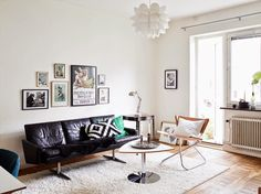 This living room is making the case for an absence of color. Wood floors gleam beside of all of this #blackandwhite.