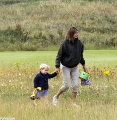Prince George on the way to the beach on his birthday with his Grandmother Carole