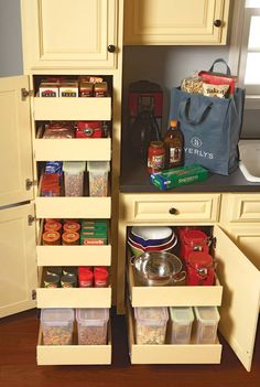 I need space-saving ideas for my small kitchen. I like these pull-out shelves as a possible solution.