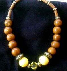 Inspired by my nzuri collection. Yellow and brown beaded necklace