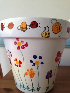 Each child has made their mark on the large flower pot! Using their fingerprint, each student has added a flower to this pot along with a ladybug or bumble bee. This will make the perfect addition to any outdoor space!