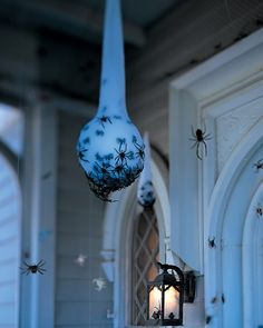 Creepy Spider Egg Sac and other front porch Halloween decor.