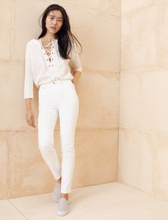 madewell libra lace-up tee worn with the high riser skinny skinny jeans + vans® sneakers.