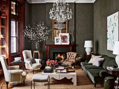 The subtly textured look of the living room walls was achieved with a Ralph Lauren Paint faux-suede finish   archdigest.com