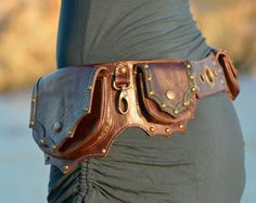 ▶○ LEATHER UTILITY BELT ○◀▶ MOULIN.R. All BROWN : BROWN Leather | Brass Hardware ◀ www.etsy.com/shop/offrandes High Quality Designer Hip Bag 100% Genuine Leather : Handcrafted with LOVE & PASSION. You will enjoy wearing this belt for many years. This Pocket Belt is a vital accessory for our Modern Nomadic Urban Lifestyle ! Perfect for traveling in some exotic location, riding around the city or dancing all night long at music festivals and concerts with your most crucial per...