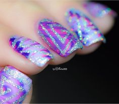 Amazing photo (and mani) by @arita888! This is a close up of her Watermarble holo swirl manicure using our Triangle Swirl Nail Vinyls found at snailvinyls.com